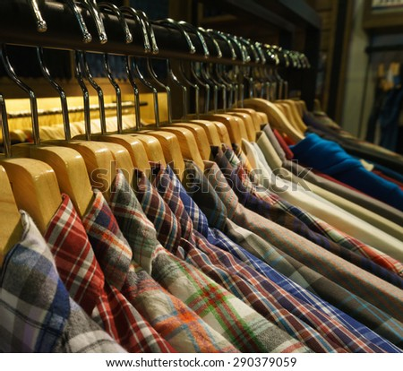 row of hanger with shirt,photo under tungsten light - stock photo
