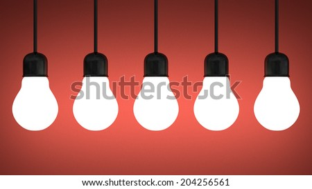 Row of hanging glowing tungsten light bulbs on red textured background - stock photo