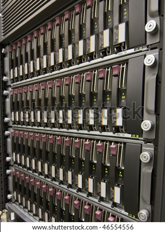 Row of hard drives mounted in a rack in a data center - stock photo