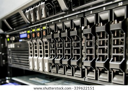 Row of harddisk slot on the computer server. - stock photo