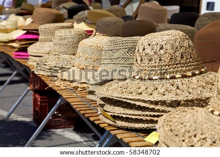 Row of hats on a market stall - stock photo
