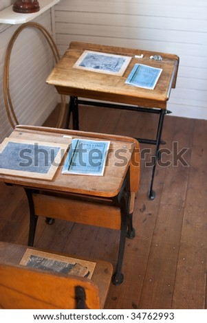 Row of heritage school desks with small chalkboards - stock photo