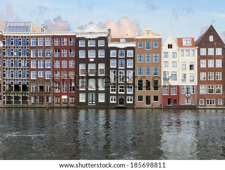 row of historic buildings over canal waters, Amsterdam, Netherlands - stock photo
