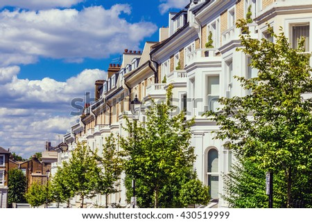 Row of houses in London's wealthy neighborhood Notting Hill. - stock photo