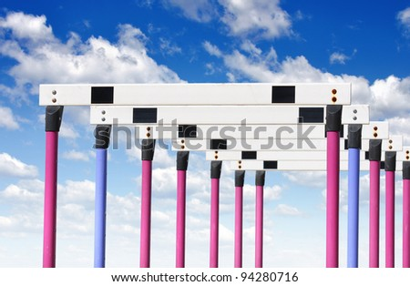 Row of hurdles for a track and field sprint hurdle race. - stock photo