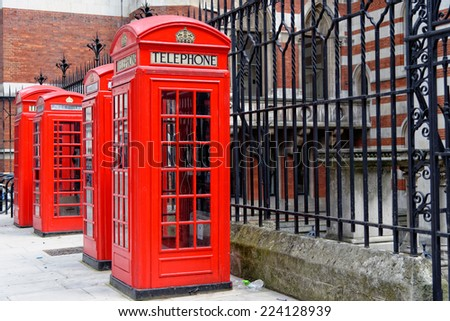 Row of iconic London red phone cabins. - stock photo
