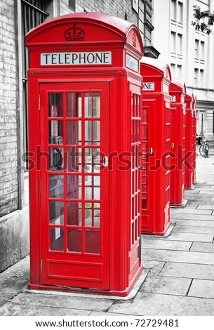 Row of iconic London red phone cabins with the rest of the picture in black and white - stock photo