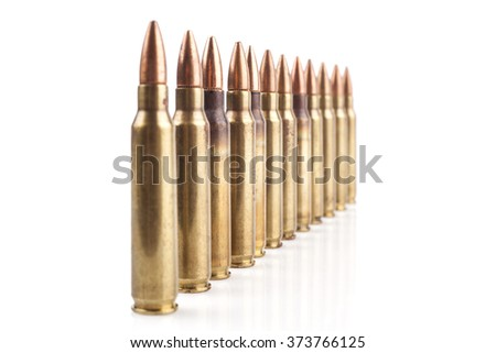 Row of  Isolated Bullets On White Background With Reflection - stock photo