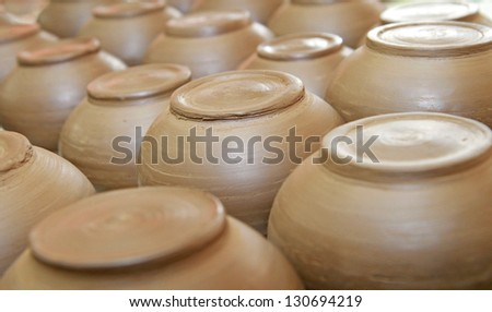 Row of just finished clay potteries - stock photo