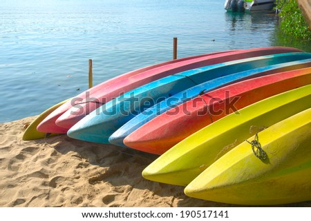 Row of Kayaks beside the sea - stock photo