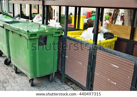 Row of large green wheelie bins for rubbish - stock photo