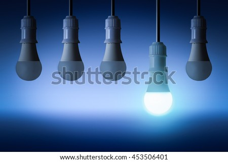 row of LED  light bulbs with glowing one , Different concept - stock photo