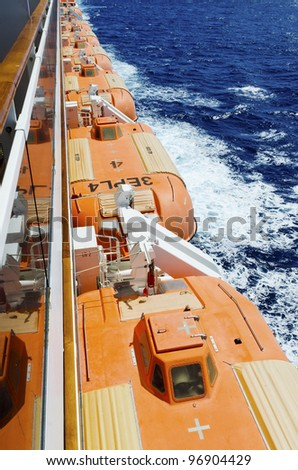 Row of lifeboats on a cruise ship - stock photo