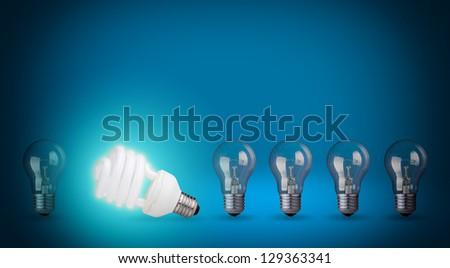 Row of light bulbs and energy save bulb. Idea concept on blue background. - stock photo