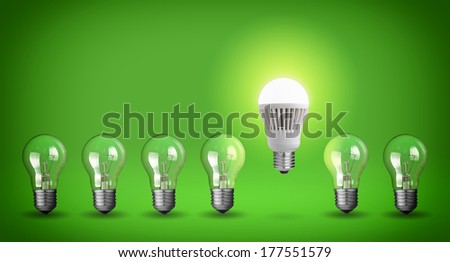 Row of light bulbs.Idea concept on green background. - stock photo