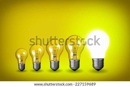 Row of light bulbs.Idea concept on yellow background. - stock photo