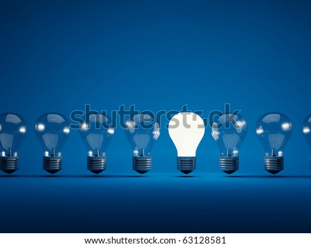 Row of light bulbs on blue background - stock photo