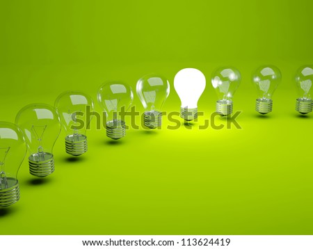 Row of light bulbs on green background - stock photo