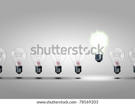 row of light bulbs with one different from the others - stock photo