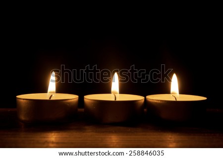 Row of lit candles