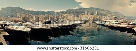 Row of luxury motor yachts in Port de Fontveille Monaco - stock photo
