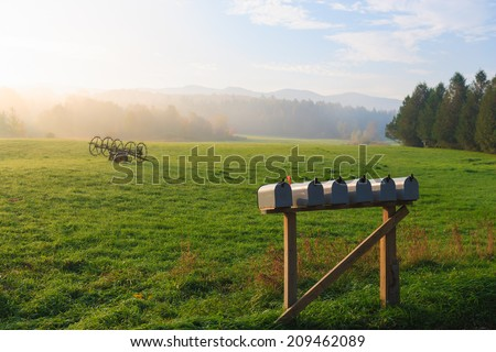Row of mailboxes in a rural enviornment, Stowe Vermont, USA - stock photo