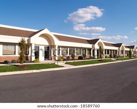 row of many business in a building in a business park - stock photo