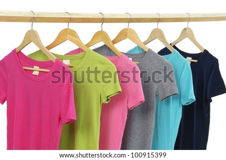 Row of many colorful shirt clothespins on rope - stock photo