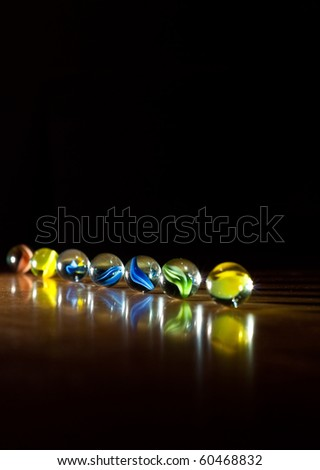 Row of Marbles in One-Point Lighting Background - stock photo
