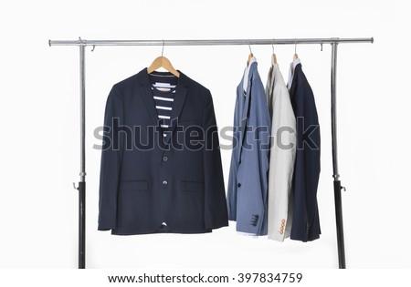 Row of men's suits hanging  - stock photo