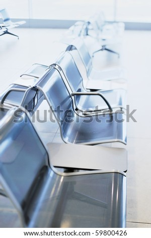 Row of metal chairs in the airport - stock photo