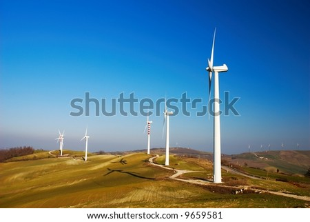 Row of modern and ecologic generators on top of a hill - stock photo