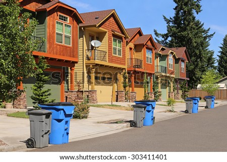 Row of modern houses in suburban neighborhood - stock photo