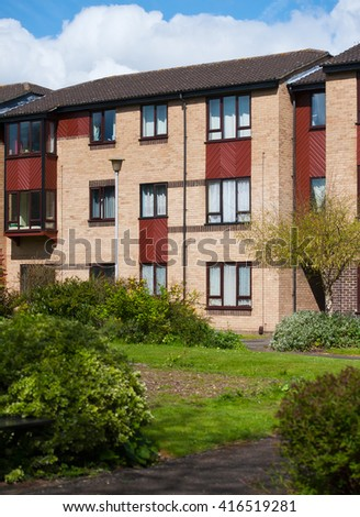Row of modern 3 storey town houses in UK street - stock photo