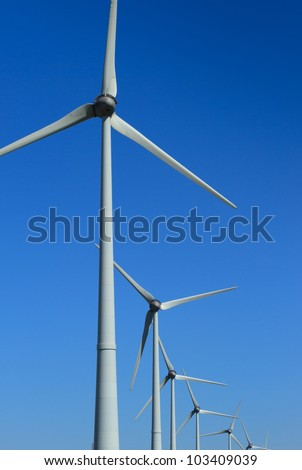 Row of modern wind turbines generating clean, renewable energy.