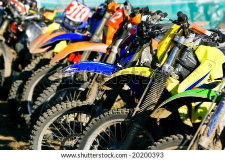 row of motobikes, close up at wheels - stock photo