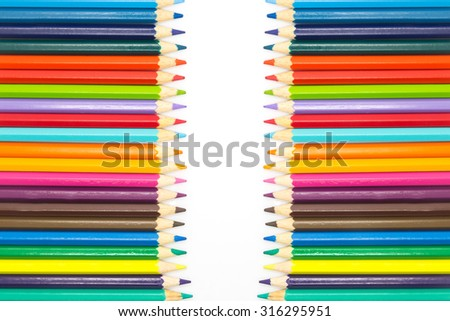 Row of multiple colors wooden pencils, on white background - stock photo