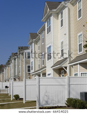 Row of new affordable townhouses - stock photo