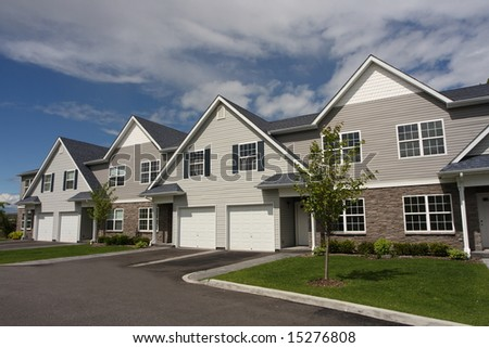 Row of new condos waiting for occupancy - stock photo