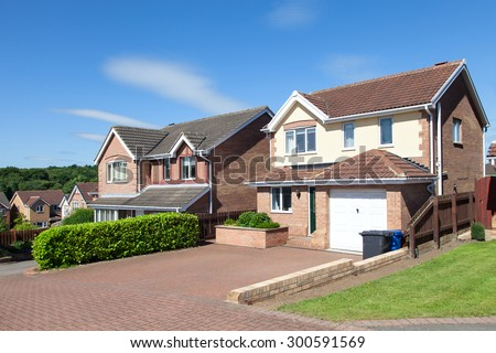 Row of new detached houses - stock photo