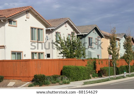 Row of new houses in suburban neighborhood - stock photo