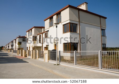 Row of new small houses in suburb - stock photo