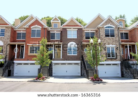Row of new town homes waiting for occupancy - stock photo