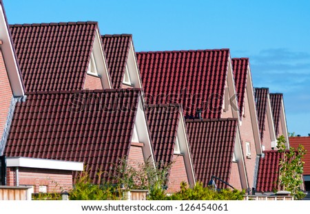 row of newly build houses in the Netherlands - stock photo