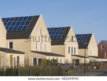 row of newly build houses with solar panels in the netherlands
