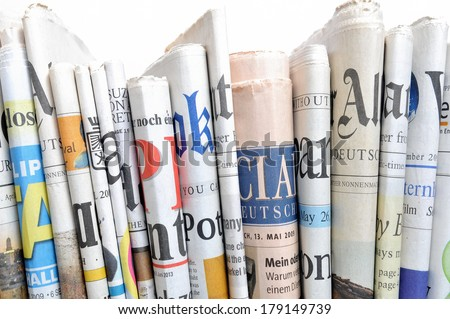 Row of newspapers - stock photo