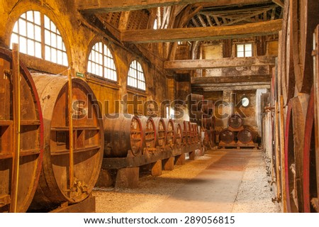 Row of oak barrels in Calvados distillery, Normandy, France