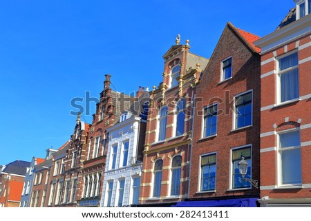 Row of old buildings on the side of the main square, Delft, Holland