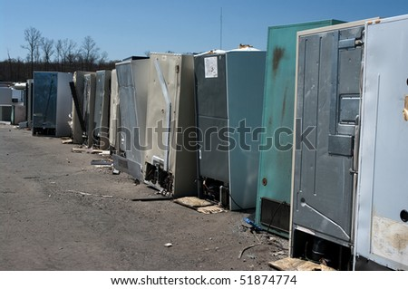 Row of old fridges for recycling - stock photo