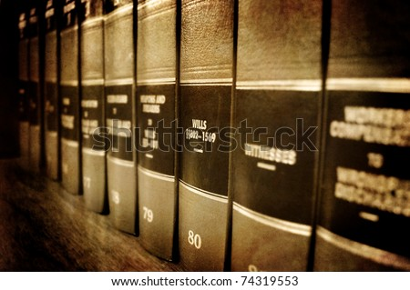 Row of old leather law books about Wills and Estates on a shelf - stock photo